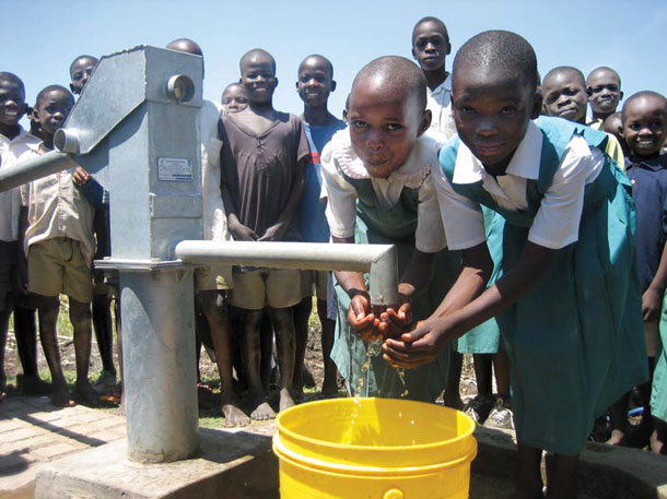 A working pump can make all the difference, as it does for these schoolgirls in Kisumu, Kenya. The pump was installed by Whites original charity, WaterPartners. | Photograph courtesy of Water.org
