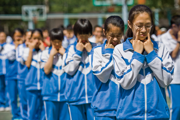 During recess, students at the Second High School Attached to Beijing Normal University—like their counterparts across the nation—gather in the courtyard to do calisthenics. This exercise is meant to aid their vision.