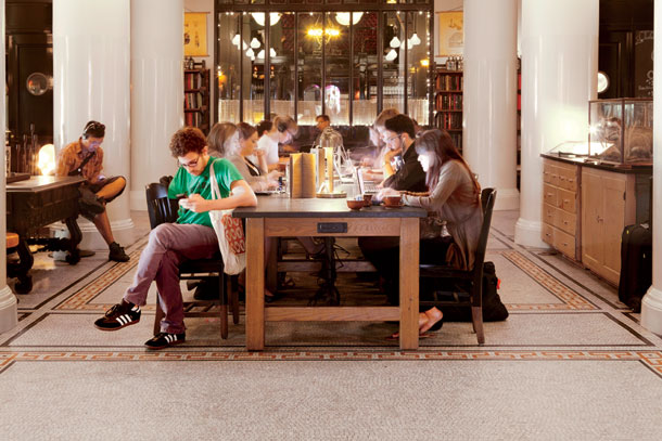 Library-style communal tables in the Ace Hotel lobby inspire both work and a bit of a brainy meat market during the day. | Photographs by Douglas Lyle Thompson