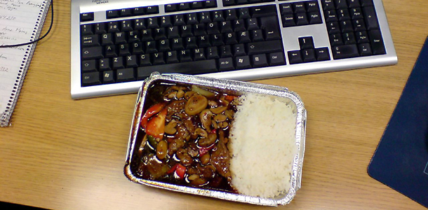 TV dinner at computer workstation