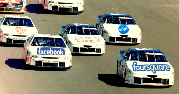 racecars with company logos