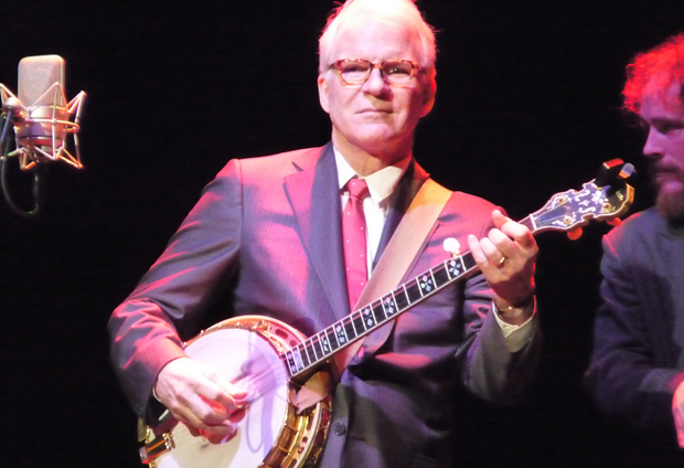 Steve Martin strums the banjo, instrument not app unfortunately