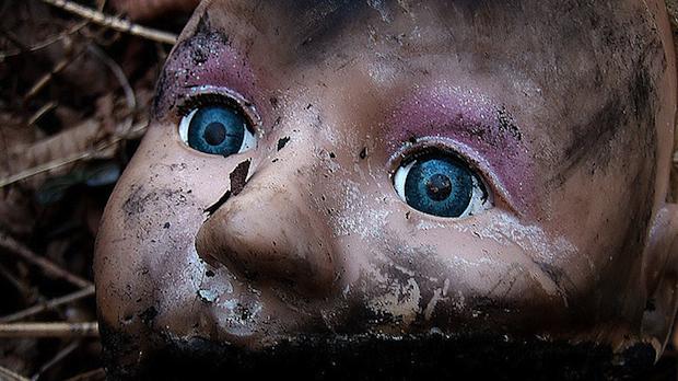 burned baby doll head