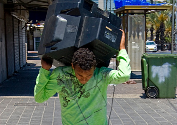 Man Carrying TV