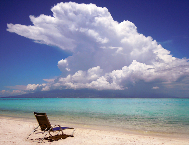 beach with clouds overhead