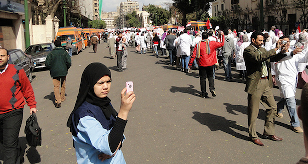 Egyptian woman on cell phone. image: Flickr user sierragoddess