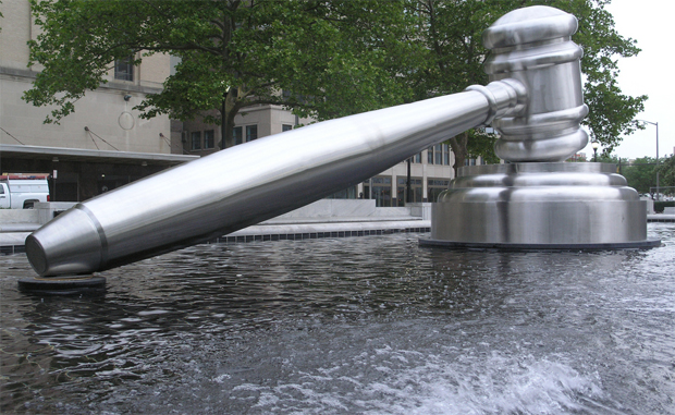 gavel in water sculpture
