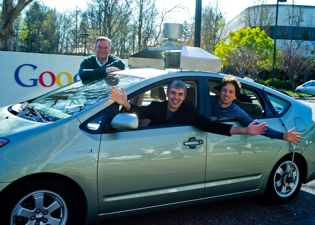 Google founders with robot car