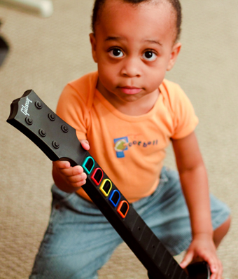 baby with guitar hero controller