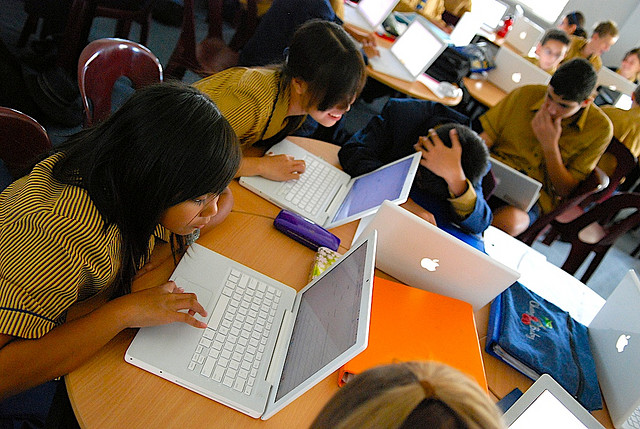students using MacBooks