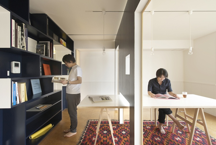 Sliding walls turn tiny apartment into home office and back co design business design - An office turned into a home ...