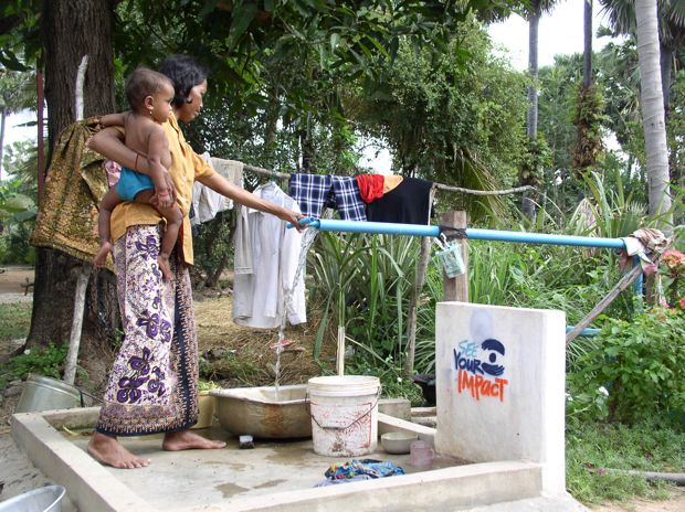 woman doing laundry outside