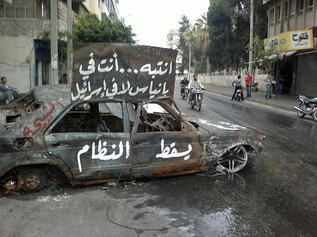 burnt car in Syria