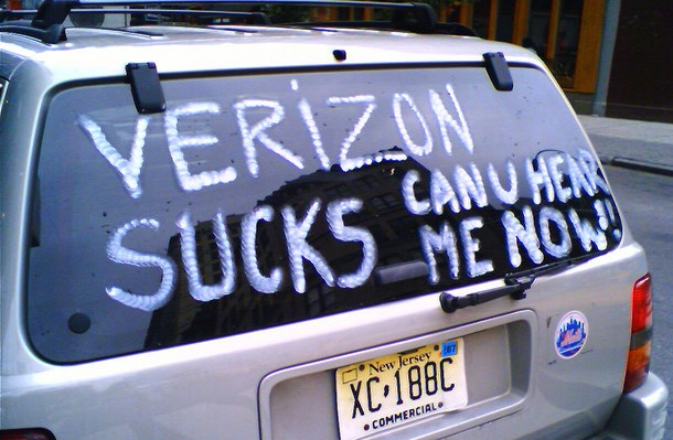 Verizon sucks sign on back of car