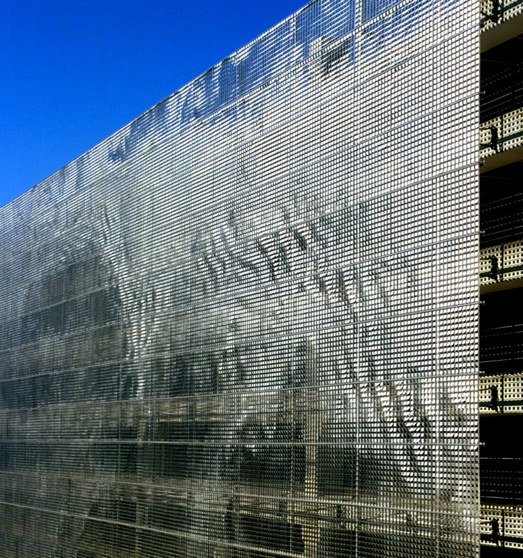 Shimmering art makes a parking garage disappear co Wind architecture