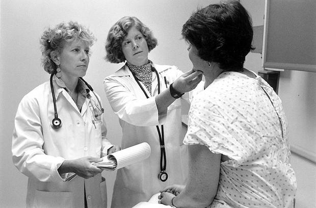 doctors examining patient