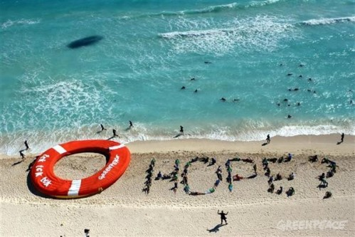Greenpeace Hope message on beach