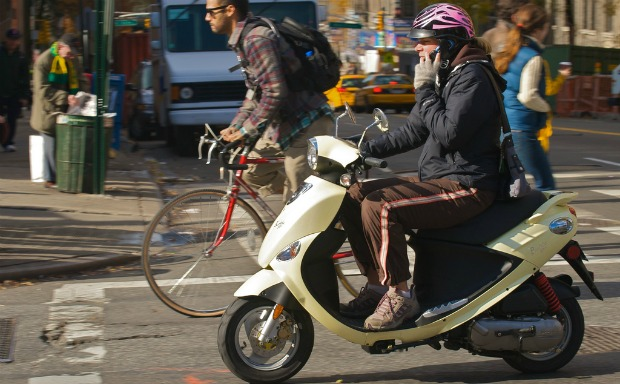 cellphone user on scooter