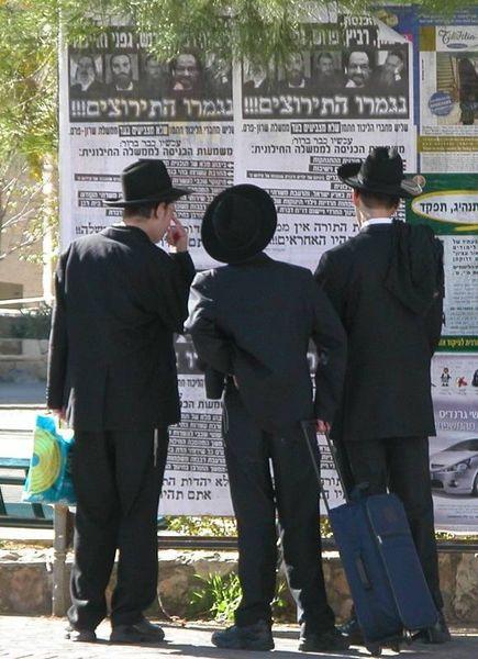 Haredi Jews reading poster