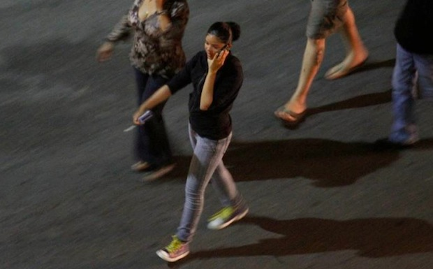 cellphone user walking
