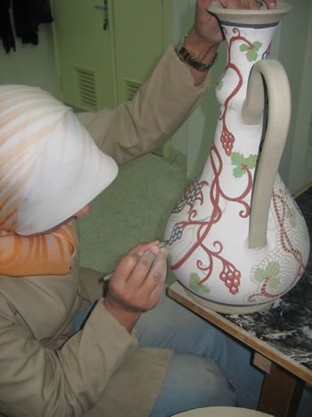 woman painting urn