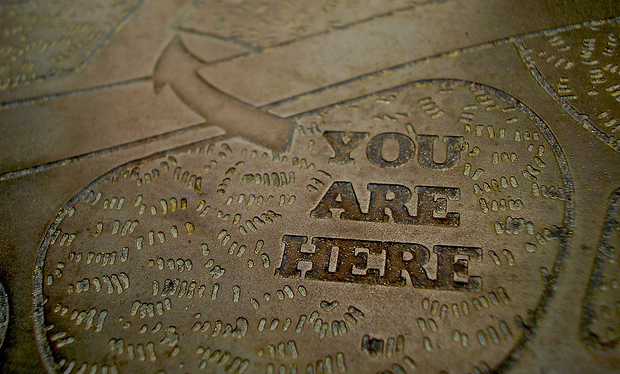 You Are Here sign in sidewalk